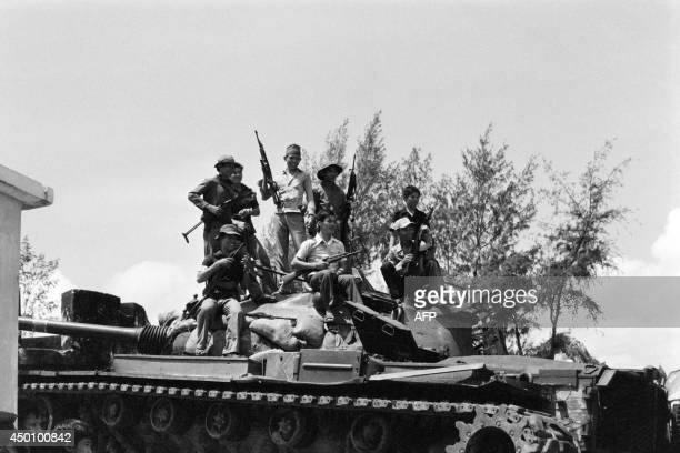 North Vietnamese soldiers pose on a tank in Da Nang, on April 21 as the town is occupied by the National Liberation Front since April 17, 1975.
