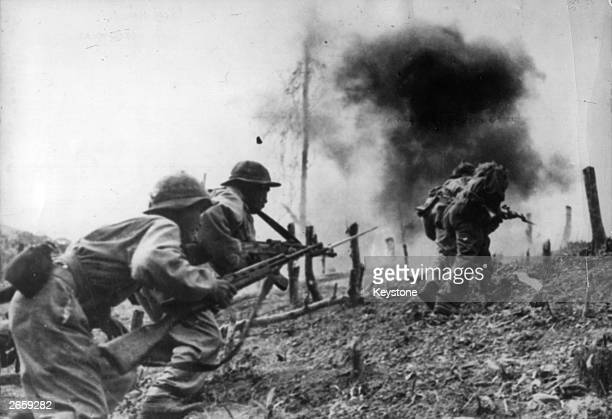 North Vietnamese troops during an assault on a South Vietnamese paratroop base at Laos during the Vietnam War.