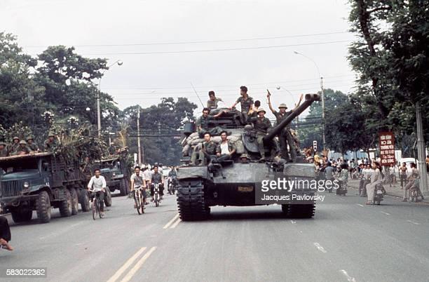North Vietnamese troops enter Saigon on tanks and trucks ending the Vietnam War