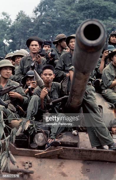 North Vietnamese troops enter Saigon on tanks ending the Vietnam War