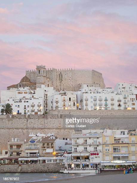 North view of Peñiscola old town and castle . Peniscola is a fortified seaport built on a rocky headland and joined to the mainland by a narrow strip...