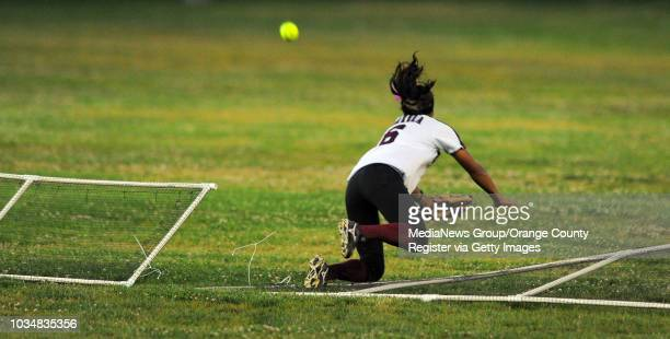 TORRANCE 04/27/11 North vs Torrance softball Torrance center fielder Courtney Varela crashes through the outfield fence as she was chasing a 2run...