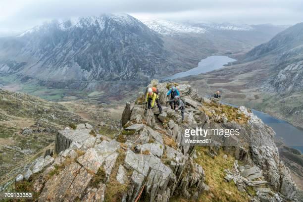 UK, North Wales, Snowdonia, Y Garn, Cwm Idwal, climbing mountaineers