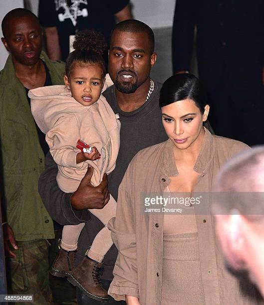 North West Kanye West and Kim Kardashian leave Kanye West Yeezy Season 2 New York Fashion Week show at Skylight Modern on September 16 2015 in New...