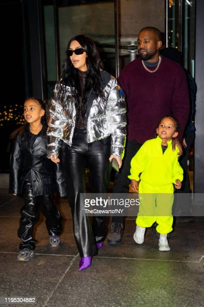North West, Kim Kardashian, Kanye West and Saint West are seen in Midtown on December 21, 2019 in New York City.
