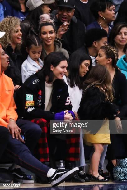 North West Kim Kardashian Kendall Jenner Kourtney Kardashian Penelope Disick and Larsa Younan watch courtside as Sierra Canyon plays Foothills...