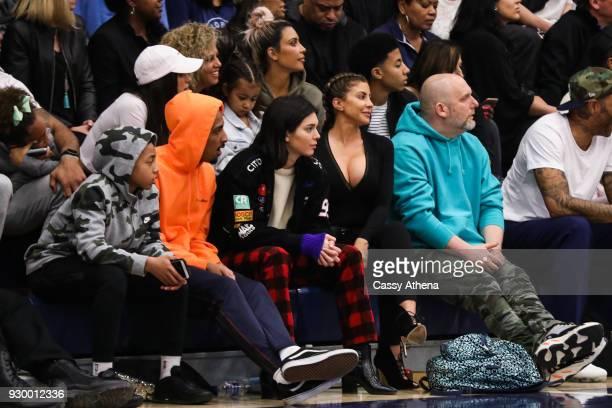 North West Kim Kardashian Taco Bennett Kendall Jenner Kourtney Kardashian Penelope Disick and Larsa Younan watch courtside as Sierra Canyon plays...