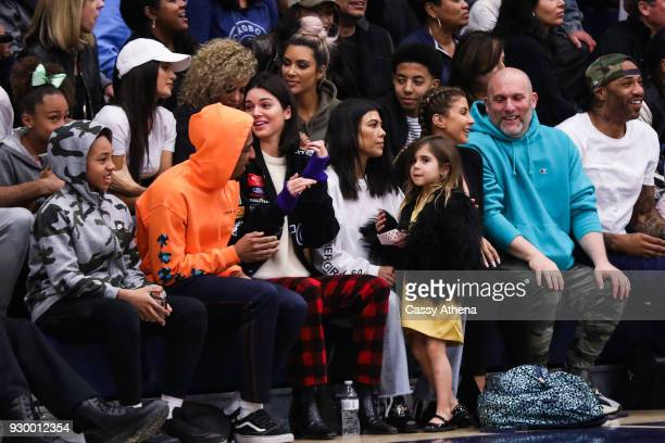 North West Kim Kardashian Taco Bennett Kendall Jenner Kourtney Kardashian Penelope Disick Larsa Younan and Kenyon Martin Sr watch courtside as Sierra...