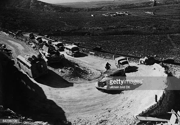 2WW Northafrica war theater german africa corps Feb41May43german advance Lorry column with supply goods on the mountain road to Derna passing a...