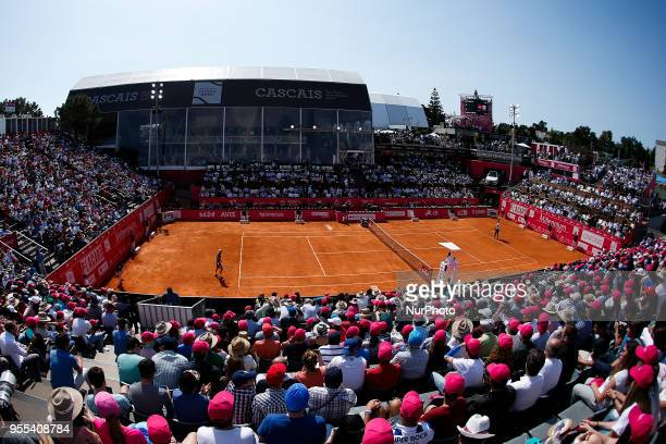 NorthAmerican tennis player Frances Tiafoe returns a ball to Portuguese tennis player Joao Sousa during their Millennium Estoril Open ATP Singles...
