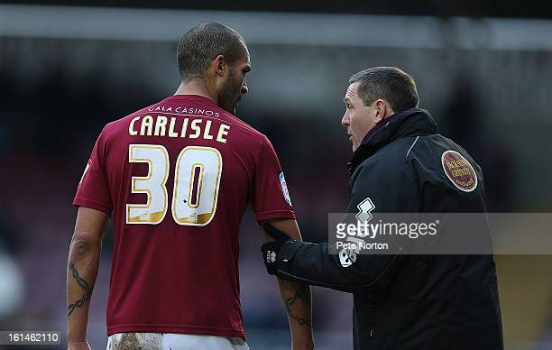 Northampotn Town manager Aidy Boothroyd gives instructions to Clarke Carlisle during the npower League Two match between Northampton Town and...