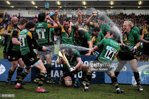Northampton captain Phil Dowson celebrates with teammates at the end of the LV Anglo Welsh Cup Final between Gloucester and Northampton Saints at...