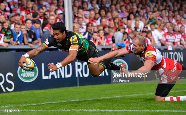 Northampton centre George Pisi beats Mike Tindall to score in the corner during the Aviva Premiership match between Gloucester and Northampton Saints...