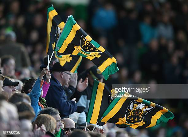 Northampton fans celebrate during the Aviva Premiership match between Northampton Saints and Harlequins at Franklin's Gardens on March 27 2016 in...