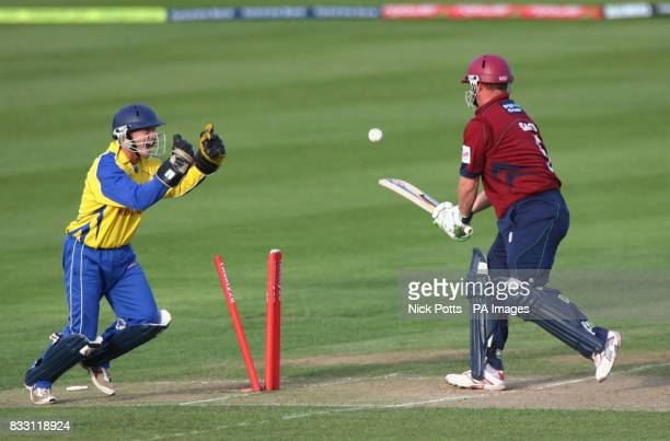 Northampton Saberers batsman David Sales is clean bowled by Warwickshire Bears captain Darren Maady as wicketkeeper Tim Ambrose celebrates during the...