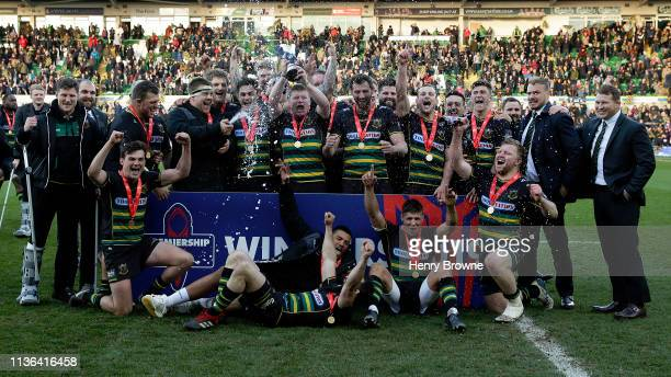 Northampton Saints celebrate with the trophy after winning the Premiership Rugby Cup Final match between Northampton Saints and Saracens at...