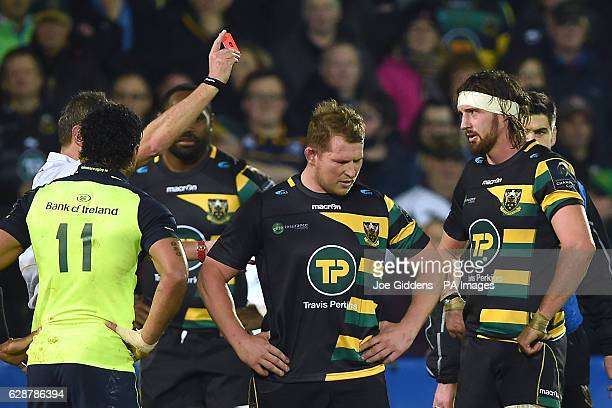 Northampton Saints' Dylan Hartley is shown a red card by referee Jerome Garces during the European Champions Cup match at Franklin's Gardens...