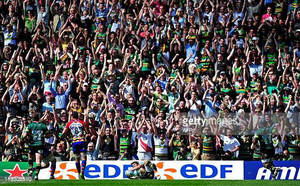 Northampton Saints' English fullback Ben Foden scores the opening try of the European Cup semifinal match between Northampton Saints and Perpignan at...