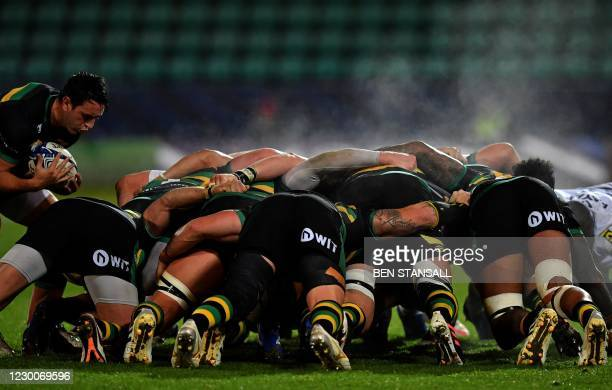 Northampton Saints' English scrum-half James Mitchell prepares to place the ball in the scrum during the European Rugby Champions Cup rugby union...