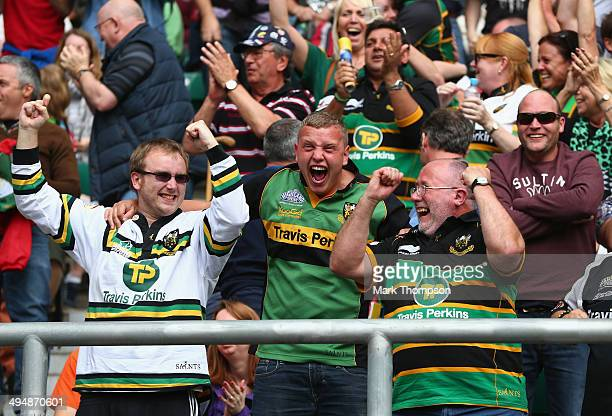 Northampton Saints fans celebrate during the Aviva Premiership Final between Saracens and Northampton Saints at Twickenham Stadium on May 31 2014 in...