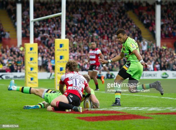 Northampton Saints' Harry Mallinder evades the tackle of Gloucester Rugby's Henry Purdy scores his sides second try during the Aviva Premiership...
