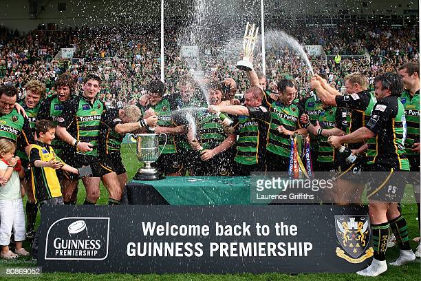 Northampton Saints led by skipper Bruce Reihana celebrate promotion to the Guinness Premiership after the National League One match between...