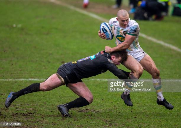 Northampton Saints' Ollie Sleightholme is tackled by Exeter Chiefs' Stuart Hogg during the Gallagher Premiership Rugby match between Exeter Chiefs...