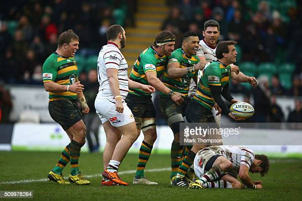Northampton saints players celebrate a try during the Aviva Premiership match between Northampton Saints and Londond Irish at Franklin's Gardens on...