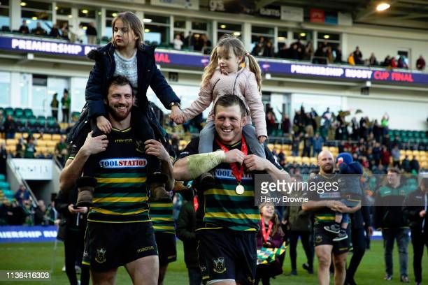 Northampton Saints players Tom Woods and Alex Waller walk around the pitch with their kids after winning the Premiership Rugby Cup Final match...