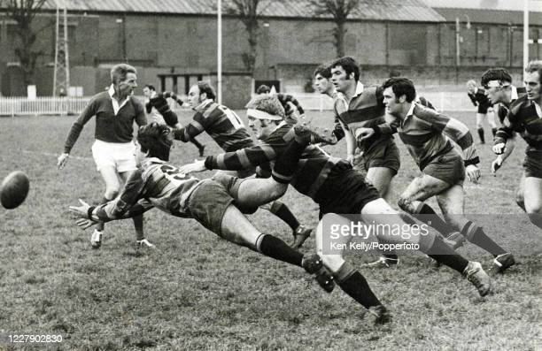 Northampton Saints scrumhalf Bob Kottler makes his dive pass as he is tackled by Chris Morrell of Moseley during the John Player Cup first round...