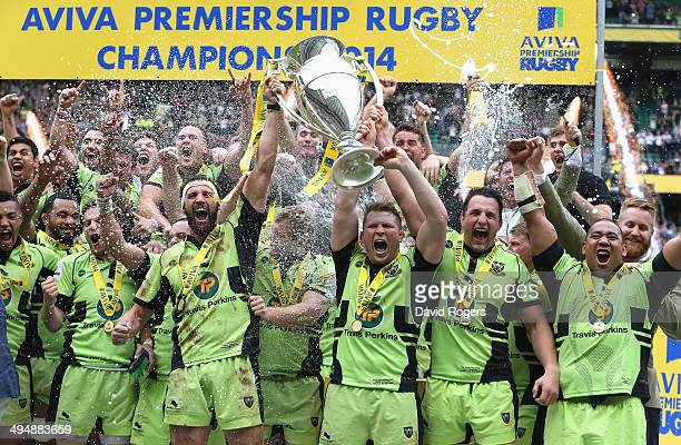 Northampton Saints team captain Dyland Hartley and match captain Tom Wood raise the trophy after their victory during the Aviva Premiership Final...