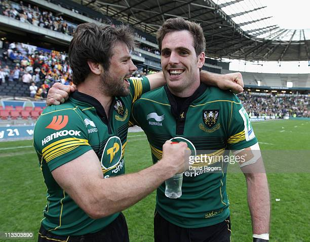 Northampton Saints try scorers Ben Foden and Jon Clarke celebrate after their teams victory during the Heineken Cup semi final match between...