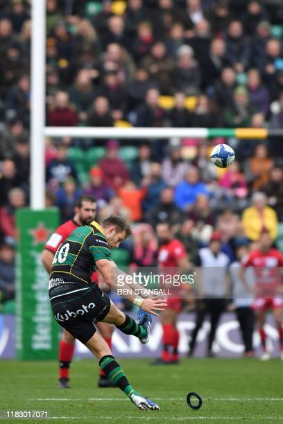 Northampton Saints' Welsh flyhalf Dan Biggar kicks a penalty during the European Rugby Champions Cup rugby union Pool 1 match between Northampton...