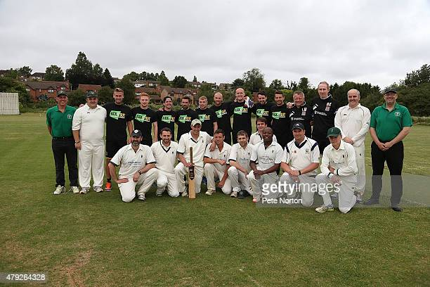 Northampton Town and Bold Dragooon players line up prior to a 20/20 Cricket Match between Bold Dragoon CC and Northampton Town FC in aid of the Leon...