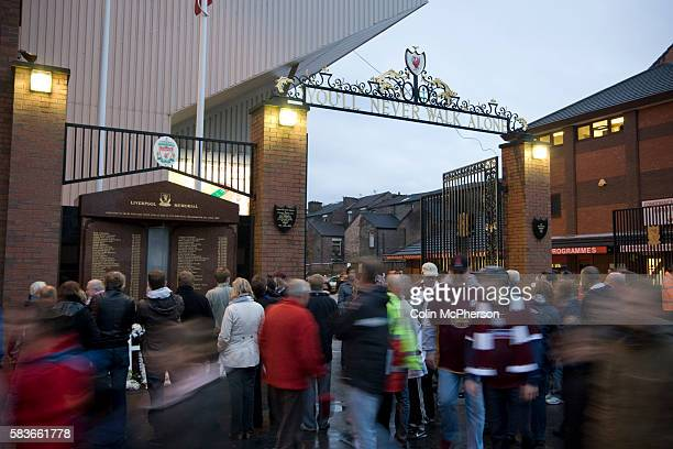 Northampton Town and Liverpool fans standing next to the Hillsborough memorial outside the Shankly Gates at Anfield before the team's Carling Cup...
