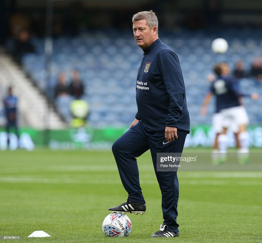 Northampton Town assistant manager David Kerslake looks on during the pre match warm up prior to the Carabao Cup first round match between Queens Park Rangers and Northampton Town at Loftus Road on August 8, 2017 in London, England.