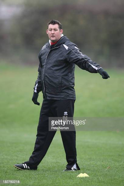 Northampton Town caretaker manager David Lee gives instructions during a training session at Moulton College on November 14, 2011 in Northampton,...