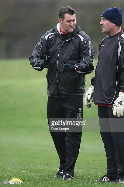 Northampton Town caretaker manager David Lee talks to goalkeeper coach Tim Flowers during a training session at Moulton College on November 14, 2011...