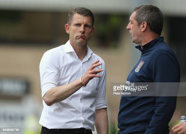 Northampton Town caretaker manager Dean Austin makes a point to Coach Andy Melville during the Sky Bet League One match between Northampton Town and...