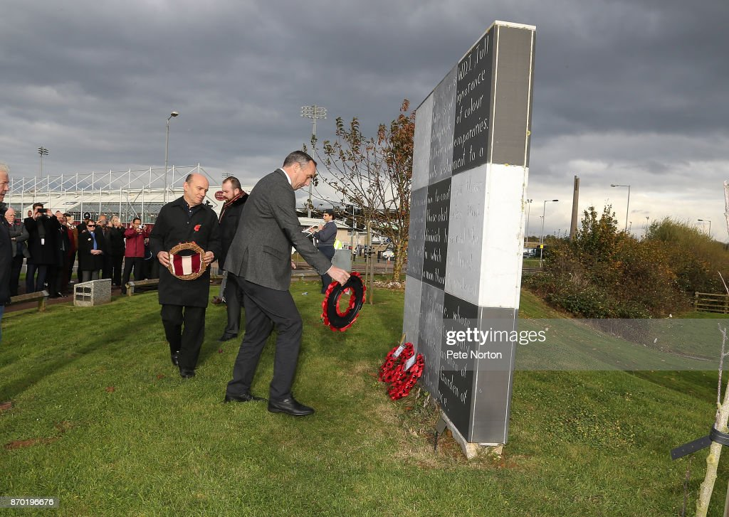 Northampton Town chairman Kelvin Thomas lays a wreath at the Walter Tull Memorial during a remembrance service prior to The Emirates FA Cup First Round match between Northampton Town and Scunthorpe United at Sixfields on November 4, 2017 in Northampton, England.