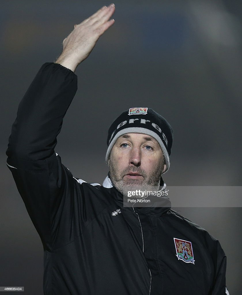 Northampton Town coach Carl Muggleton gives instructions during the Sky Bet League Two match between Northampton Town and Carlisle United at Sixfields Stadium on March 17, 2015 in Northampton, England.