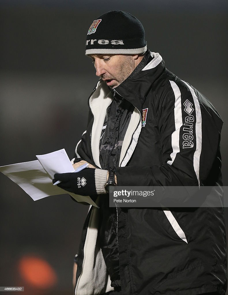 Northampton Town coach Carl Muggleton makes notes during the Sky Bet League Two match between Northampton Town and Carlisle United at Sixfields Stadium on March 17, 2015 in Northampton, England.