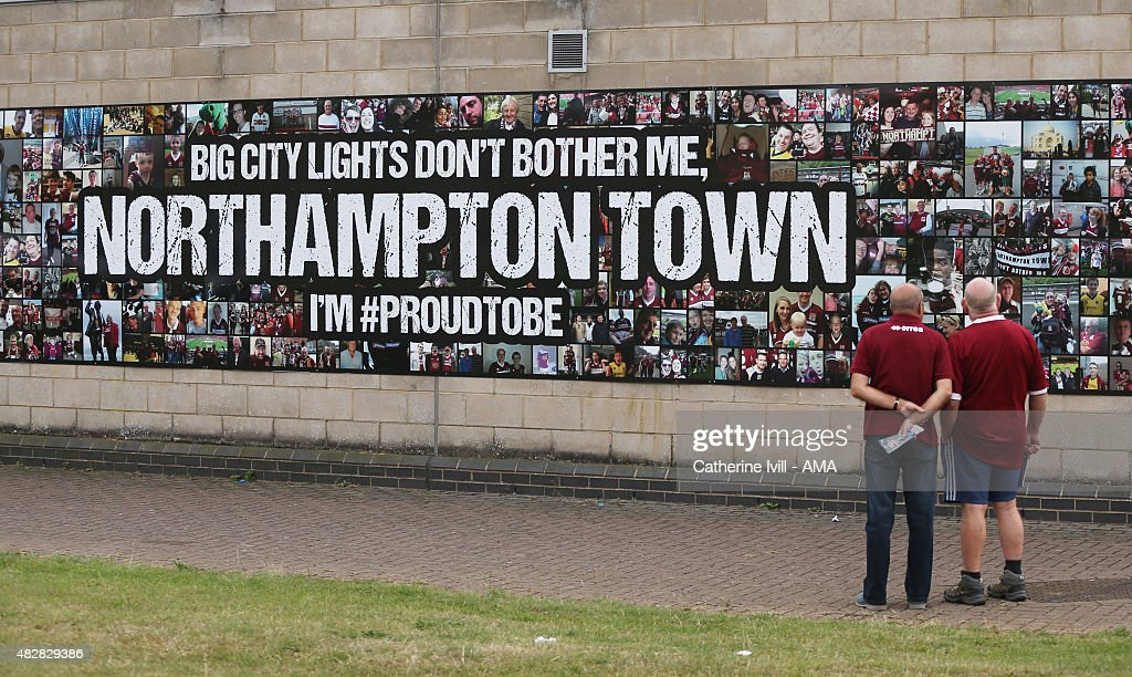 Northampton Town Fans look at a mural at Sixfields stadium before the pre-season friendly between Northampton Town and Derby County at Sixfields on July 18, 2015 in Northampton, England.