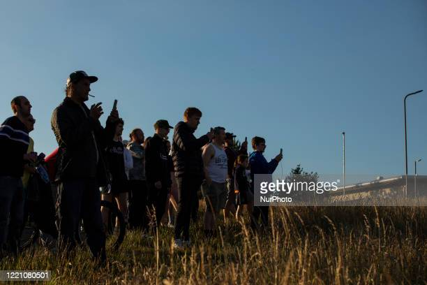 Northampton Town fans watching their side on the bank of the PTS Academy Stadium during the League Two Playoff match against Cheltenham Town at the...