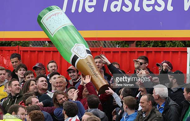 Northampton Town fans with a large inflatable champagne bottle prior to the Sky Bet League Two match between Exeter City and Northampton Town at St...