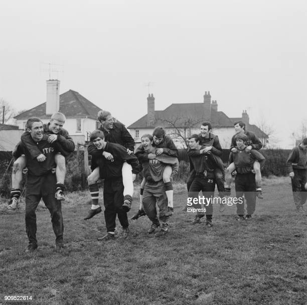 Northampton Town FC players carry each others piggyback during a training session UK 23rd December 1968