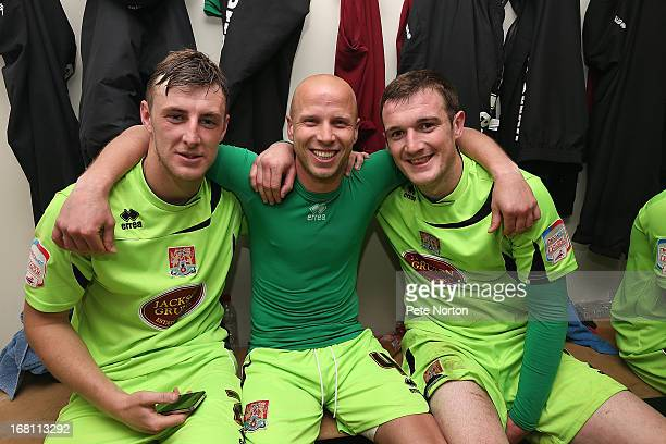 Northampton Town goal scorer Luke Guttridge celebrates with teammates Lee Collins and John Johnson in the changing room after the npower League Two...