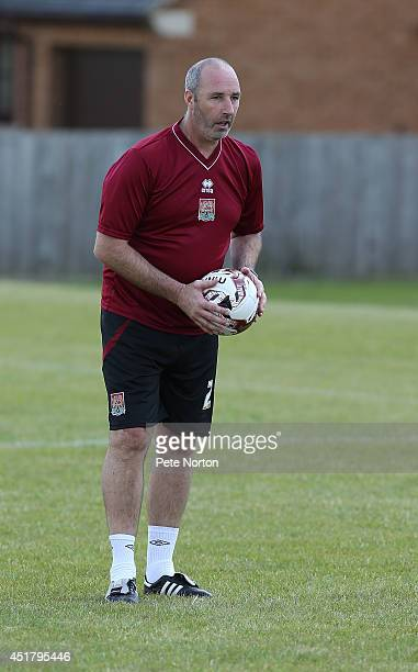 Northampton Town goalkeeper coach Carl Muggleton looks on during a training session at Moulton College on July 1 2014 in Northampton United Kingdom