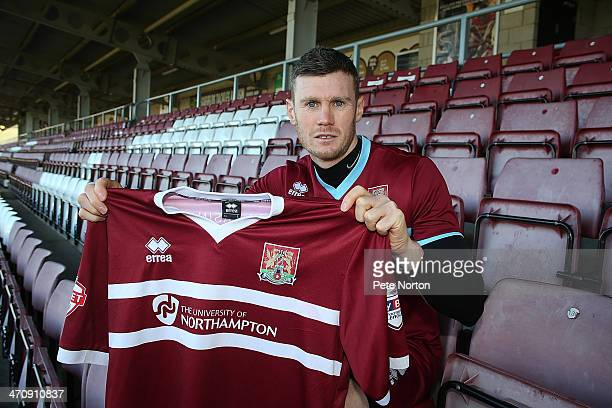 Northampton Town loan signing Zander Diamond poses with a shirt during a photo call at Sixfields Stadium on February 21 2014 in Northampton England
