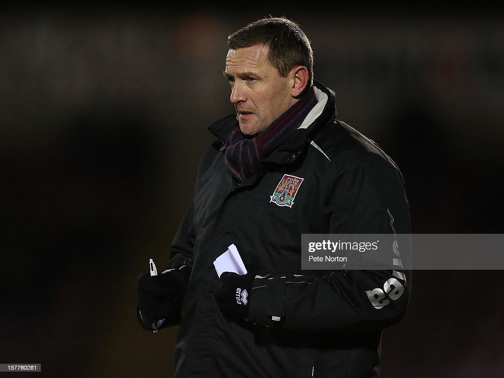 Northampton Town manager Aidy Boothroyd looks on during the Johnstone's Paint Trophy Quarter Final match between Northampton Town and Leyton Orient at Sixfields Stadium on December 5, 2012 in Northampton, England.